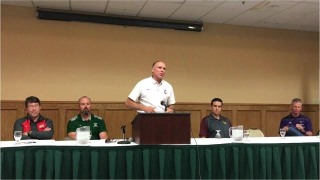 Carroll College football coach Mike Van Diest talks at the recent Frontier Conference Media Day function in Great Falls.