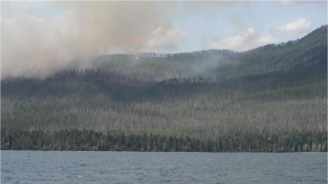 Airplanes that scoop water and drop it onto fires were busy at the Howe Ridge fire in Glacier National Park Sunday.