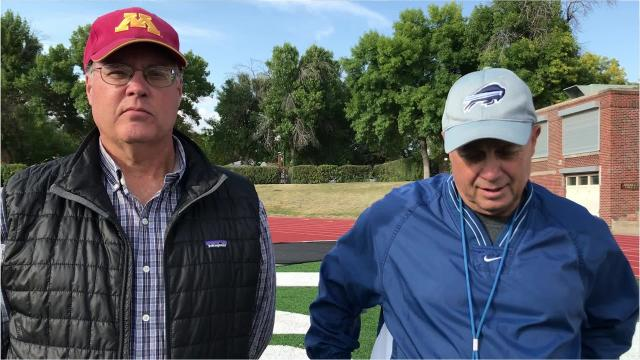 Great Falls High football coach Mark Samson and Tribune columnist Scott Mansch walk 100 yards while discussing the Bison game Friday night at Billings West
