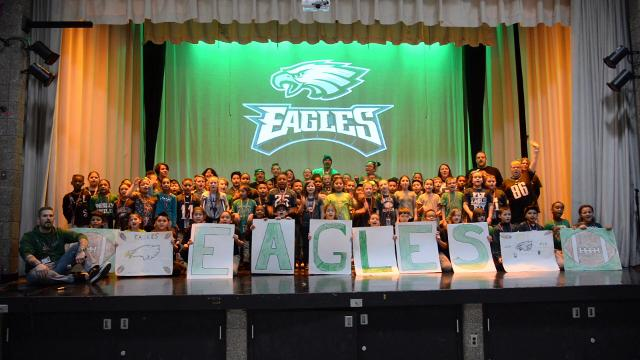 Third-grade students and faculty members perform the Eagles fight song during a Super Bowl Eagles pep rally at Dr. William Mennies Elementary School in Vineland.