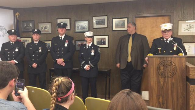 Millville firefighters were awarded medals Tuesday night for their roles in a Dec. 31, 2017 house fire in which an injured man was rescued.