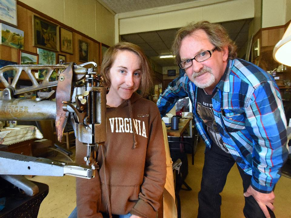 David Young and his daughter, Yvonne Young, at Graham's Shoe Repair keep Appalachian Trail hikers on the trail, sharing in their stories and developing friendships with them each year.