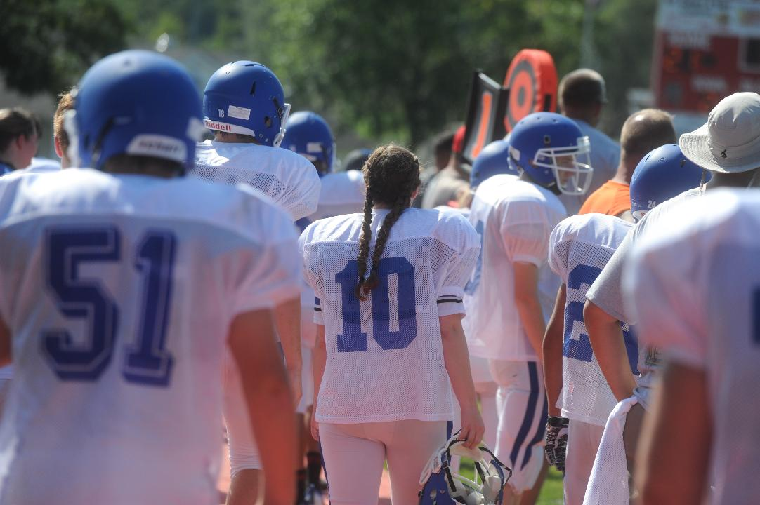 Fort Defiance varsity football kicker Sophie Hodge walks 100 yards with sports reporter Patrick Hite, answering questions along the way.