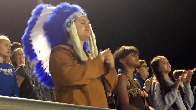 Fort Defiance freshman Ryland Oakes and junior Angie McCauley help lead the student section in cheering on the Indians, even on a night when their team lost by 40 points.