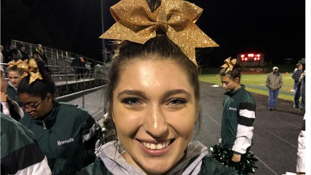 Kelsey Wolfe talks about cheering for Wilson Memorial before she gives a cheer lesson to The News Leader's Patrick Hite