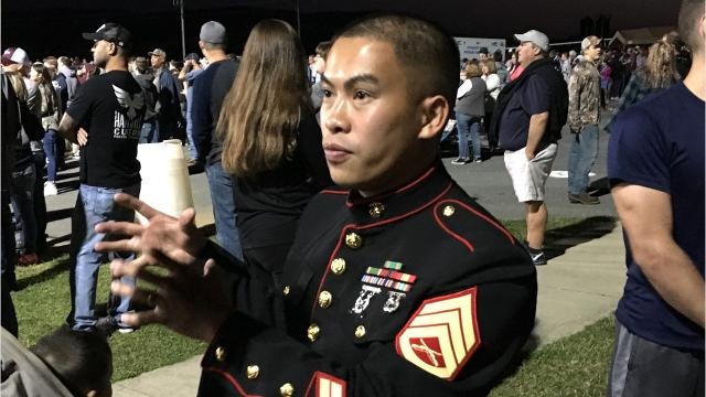 Marine Staff Sgt. Tung Nguyen discusses his role at high school football games