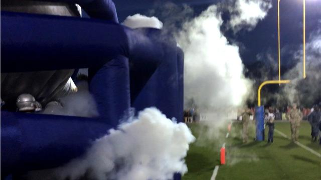 Jared Moss and David Tibbs discuss the inflatable helmet Lee High football players run through before every home game.