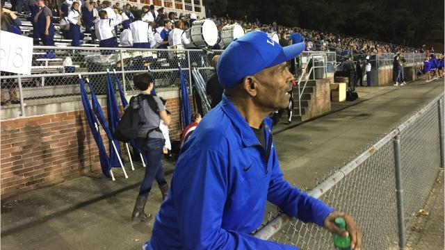 John Davis drives the bus for many Lee High sports, including football, basketball and volleyball. But when he's not on the bus, he's cheering on the Leemen.