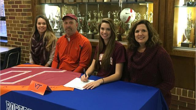Lee High senior Jennifer Williams will play volleyball for Virginia Tech next year. She celebrated with her family and friends at the high school Friday afternoon.