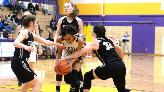 With the scored tied and the clock winding down in the fourth quarter Saturday night, Waynesboro's De'nia Jones puts up a shot that sends the Little Giants into the semifinals.