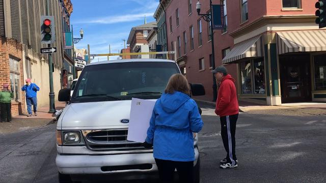 A man in a van appeared to try and intimidate marchers with his van Saturday in Staunton before driving away.