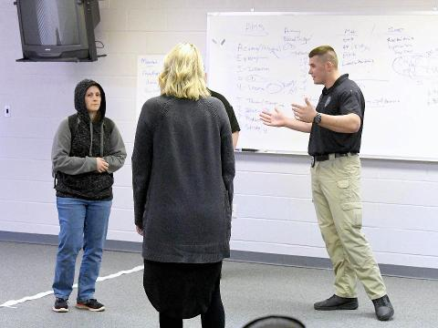 Members of local law enforcement, first responders and community services board learn crisis intervention through Crisis Intervention Team (CIT) training.