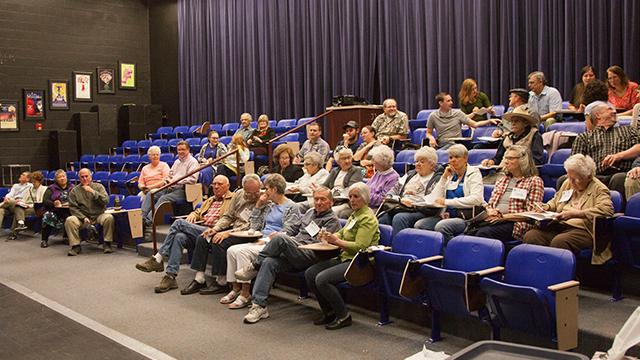 Washington County residents attend caucus meetings to discuss and elect representatives Tuesday, March 20, 2018.