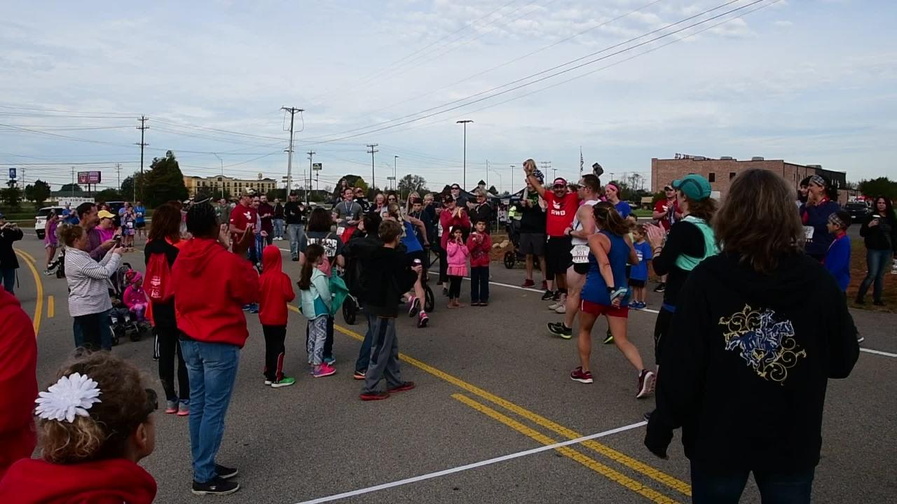KaLea Lehman of Clarksville tries to break the Guinness World Record for the fastest half-marathon completed while pushing a triple stroller at Clarksville's Go Commando Half Marathon on Saturday.