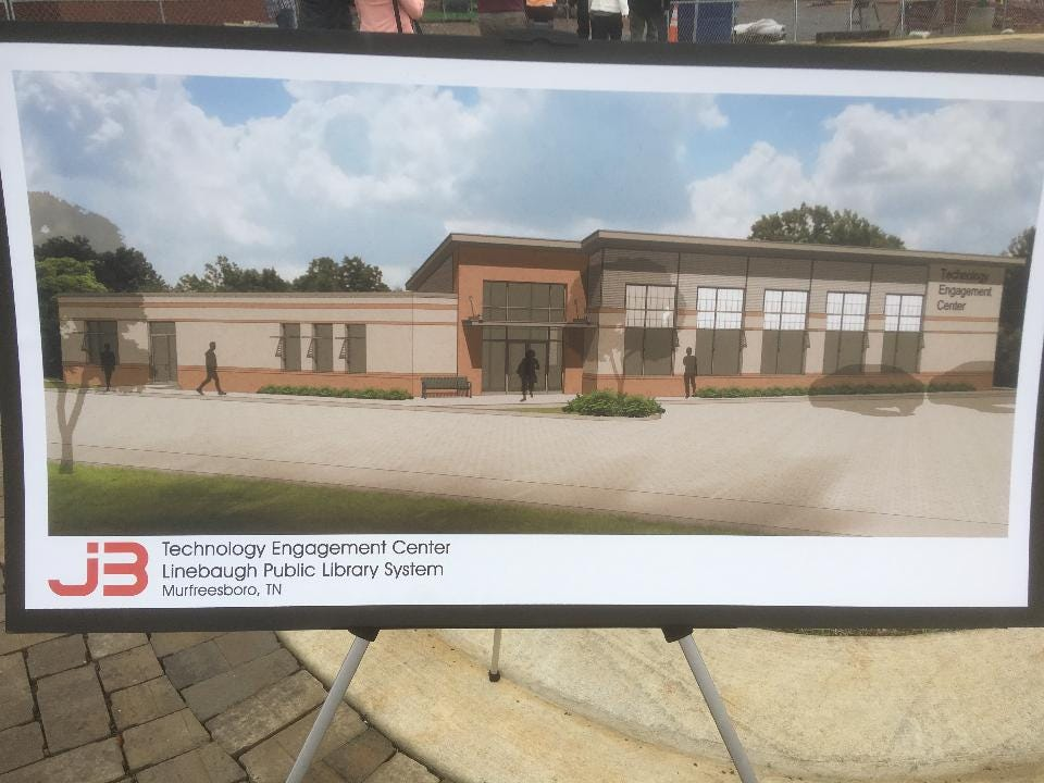 Rita Shacklett, director of Linebaugh Public Library System, talks about future Technology Engagement Center with Alan Couch, who will serve as the branch librarian for a center that's scheduled to open by June on the Hobgood Elementary campus.