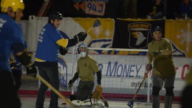 County and 101st play broomball game at Downtown Commons