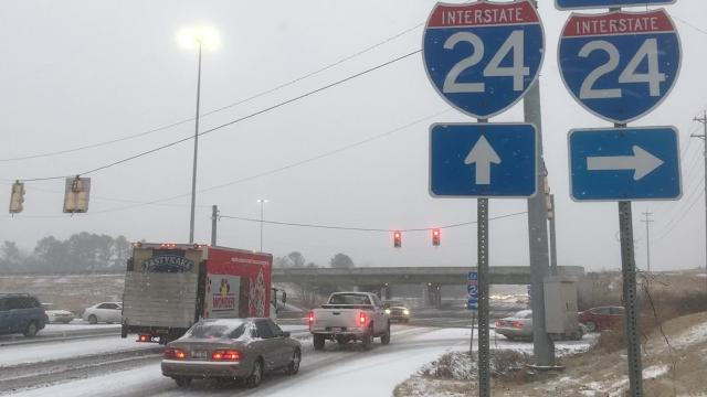 Almaville Road and Interstate 24 traffic moved at a slow, steady pace while snow piled onto the highways at about 7:30 a.m. Tuesday.