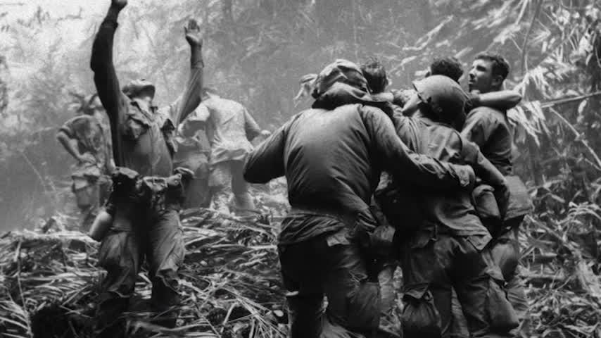 It was another dangerous day in Vietnam in 1968, nearly 50 years ago, when 101st Airborne soldiers Dallas Brown and Tim Wintenburg were photographed in one of the most iconic pictures of the Vietnam War. (AP Video)