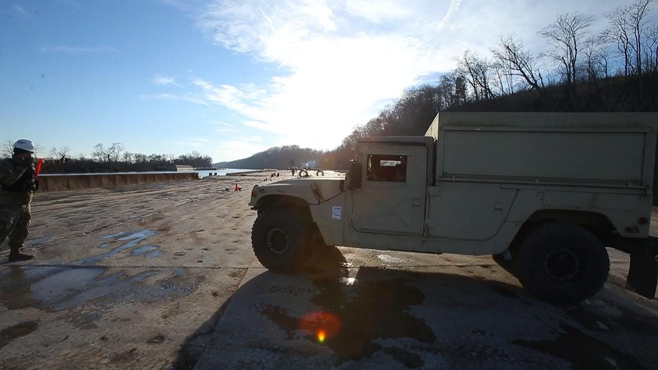 2nd Brigade loads barge to prepare for training in Louisiana