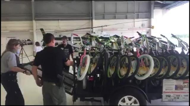 Deputies assemble bikes for needy kids