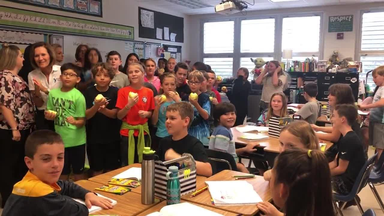 Fifth grade students at Sea Gate Elementary celebrate Friday, Feb. 23, 2018, after their teacher, Hope Cliff, received a Golden Apple award from Champions For Learning.