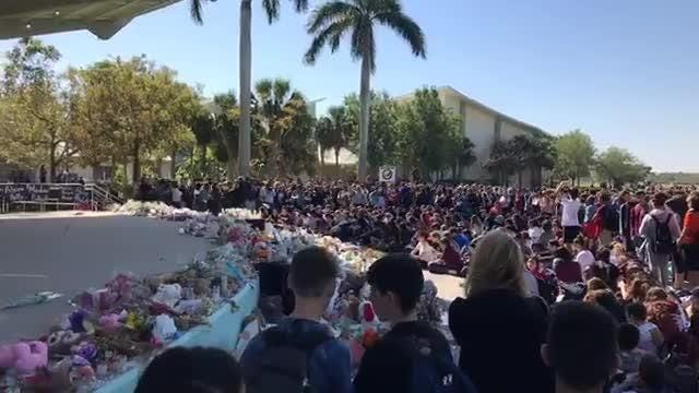 Students from Marjory Stoneman Douglas High School at Pine Trails Park in Parkland, Florida on March 14, 2018. Watch the Facebook Live recording.