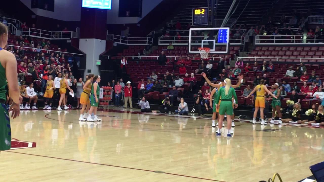 FGCU players celebrate (sort of; they expected this) FGCU's big win.