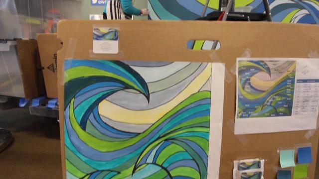 Bainbridge artist Cynthia Lait is painting a mural inside the island's ferry terminal.