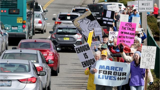 Hundreds of people joined a march to protest gun violence in Silverdale on Saturday.