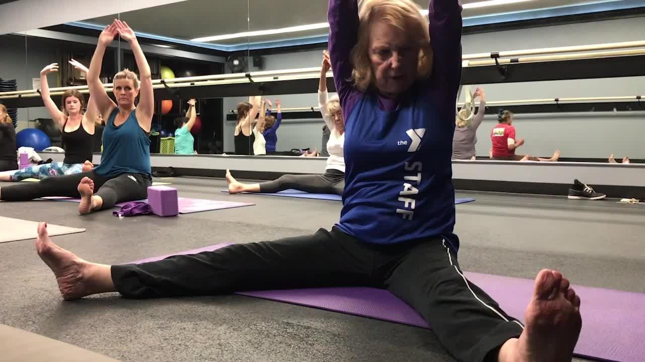 Rae Beebe, 88 years old, instructs a yoga class at the Ventura Family YMCA.
