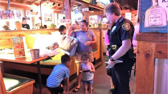 Police serve customers at Texas Roadhouse