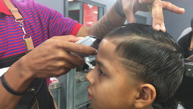 Barbershop gives free haircuts to boys in need