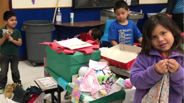 Crockett Elementary students receive gifts, toys