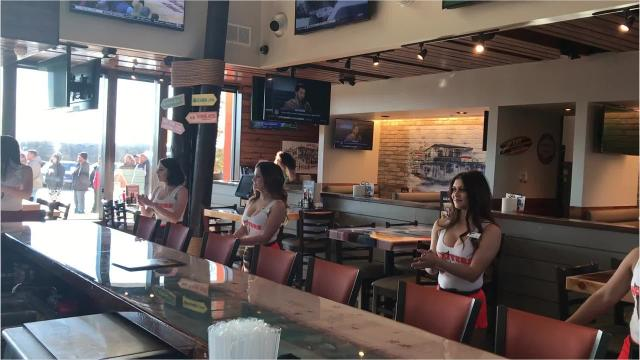 """The Hooters girls sing a modified version of AC/DC's """"You Shook Me All Night Long"""" before opening the doors to the new Abilene location on Tuesday, Jan. 16, 2018."""