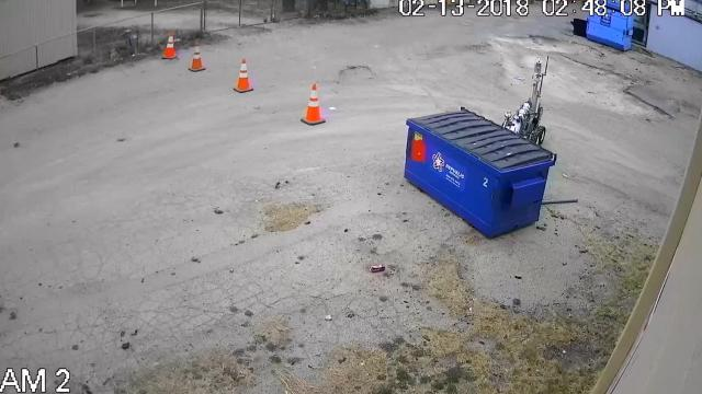 Adobe Signs & T-Shirts shared security footage of Abilene bomb squad robot disposing of a suspicious package.
