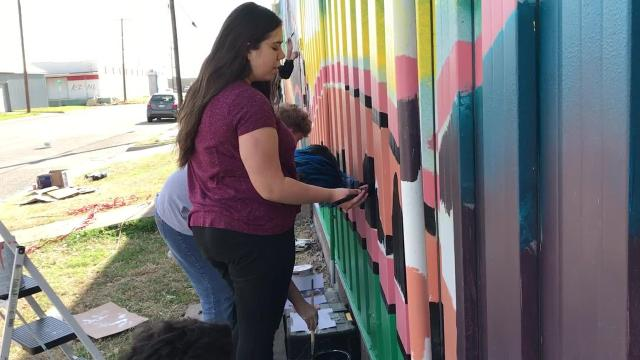 Students from the Grand Prairie Fine Arts Academy created an innovative 3-D mural in Abilene's SODA district in conjunction with Palette of Purpose one weekend in March 2018.