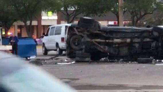 Black Dodge 3500 pickup turned over on its side at Napa Auto Parts store on July 7, 2018.
