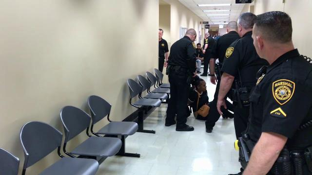 Shasta County marshal's deputies arrest and subdue a woman who caused a courtroom disturbance.