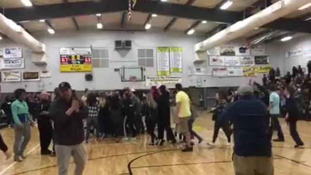 This video from Wednesday's Enterprise High School girls basketball victory shows people trying to stop the woman police believe attacked a referee just after the game ended.