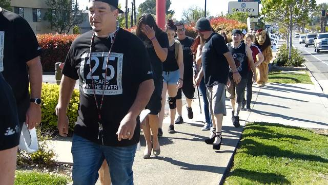 About a hundred people marched in heels down Hilltop Drive for One SAFE Place's annual Walk a Mile in Her Shoes event.