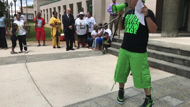 Michael Marsh spoke Friday in front of the Indian River County Courthouse with Towanna Ruffin and Yolanda Woods, mothers of Andrew Coffee IV and Alteria Woods, standing behind him.