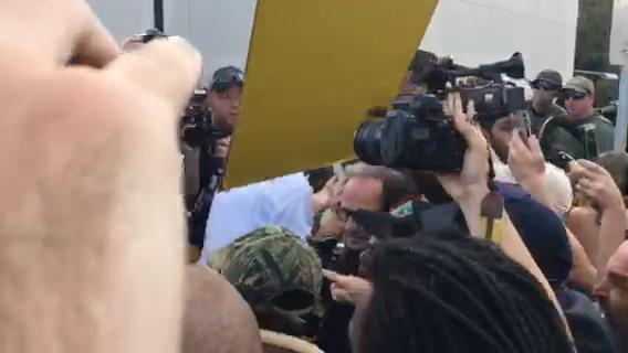 People in attendance at Richard Spencer's speech at the University of Florida in Gainesville are surrounded by protesters.