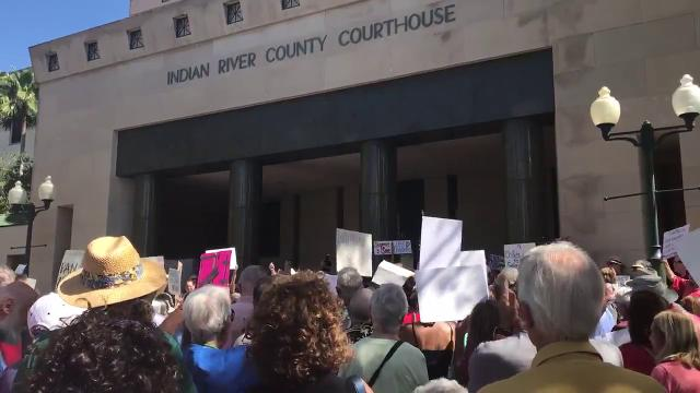 People gather to call for changes in gun laws at the Indian River County Courthouse Feb. 21, 2018.