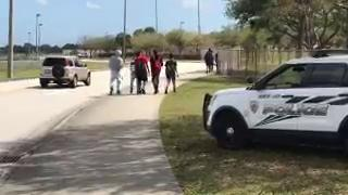 Almost a dozen students walked away from St. Lucie West Centennial High School in protest of gun violence Feb. 21, 2018.