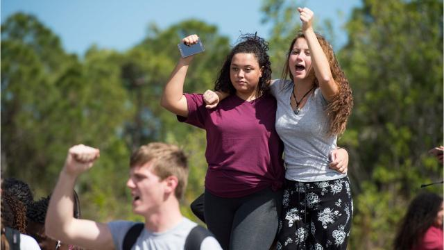"""We want change,"" ""Douglas strong,"" ""more kids, less guns,"" chanted at least 100 Port St. Lucie High School students as they made their way to the front gates of the school in a peaceful protest honoring the 17 slain Marjory Stoneman Douglas High School students on Wednesday, Feb. 21, 2018 at the school in Port St. Lucie."