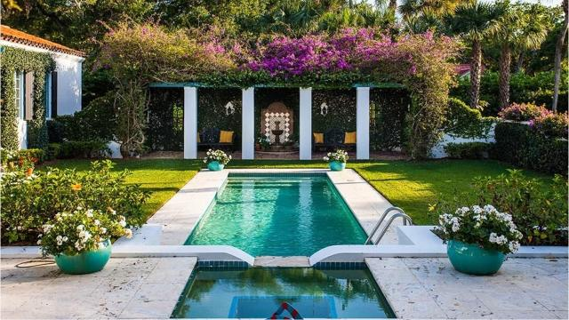 This $3.95 million Mediterranean inspired home is on a tree canopied lot in picturesque Riomar.
