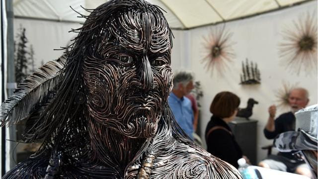 Opening day of the 67th annual Under the Oaks Fine Arts & Crafts Show at Riverside Park was March 9, 2018, in Vero Beach. More than 200 artists have displays under the oaks. ERIC HASERT/TCPALM