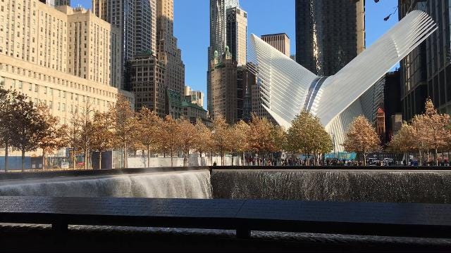 Wind blowing water out of the North Tower footprint at the World Trade Center Memorial Site.