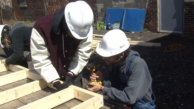 Students learn skills to build a tiny house