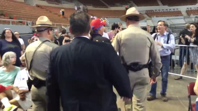 Trump supporter refuses to change shirt, removed from rally